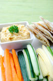 Healthy dip humus and raw vegetable sticks Stock Image