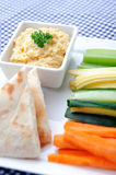 Healthy dip humus and raw vegetable sticks Stock Photography