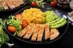 Healthy dish with chicken, tomatoes, avocado, lettuce and lentil Royalty Free Stock Images