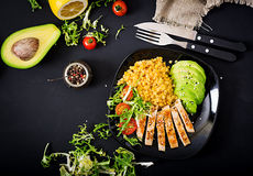 Healthy dish with chicken, tomatoes,  avocado, lettuce and lentil Royalty Free Stock Photo