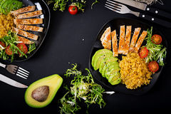 Healthy dish with chicken, tomatoes, avocado, lettuce and lentil Stock Photos