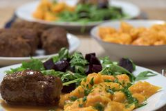 Healthy dish - roast beef roulade, carrot dumplings and rucola s. Alad with red beetroot Royalty Free Stock Images