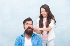 With healthy dose of openness any dad can excel at raising girl. Child making hairstyle styling father beard. Being. Parent means present for kid interests stock photos