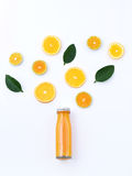 Healthy drink, bottle of orange juice with slice orange fruit an Royalty Free Stock Photography