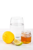 Healthy drink with honey, lemon and lime Royalty Free Stock Images