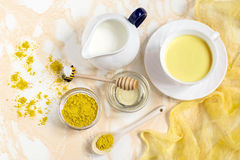 Healthy drink: milk with turmeric and honey Royalty Free Stock Photography
