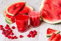 Healthy drinks. watermelon and raspberry smoothies on white wooden background stock image