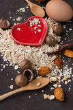 A Healthy Dry Oat meal with nut and Red heart in a wooden spoon Royalty Free Stock Photos