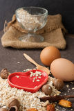 A Healthy Dry Oat meal with nut and Red heart in a wooden spoon Royalty Free Stock Image