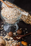 A Healthy Dry Oat meal with nut in a wooden spoon Stock Photos