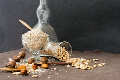 A Healthy Dry Oat meal with nut in a wooden spoon Stock Photo