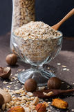 A Healthy Dry Oat meal with nut in a wooden spoon Stock Images