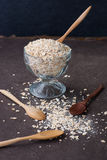 A Healthy Dry Oat meal in a wooden spoon Royalty Free Stock Photography