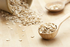 Healthy Dry Oatmeal in a wooden spoon Royalty Free Stock Image