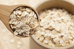 Healthy Dry Oatmeal in a wooden spoon Royalty Free Stock Photo