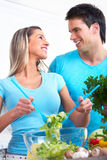 Healthy eating. Young love couple  drinking milk and eating cereals. Over white background Stock Photo
