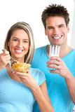 Healthy eating. Young love couple  drinking milk and eating cereals Royalty Free Stock Photo