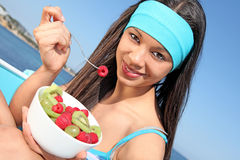 Healthy eating. Young woman eating fruit Stock Images