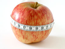 Healthy eating. Apple with tape measure Royalty Free Stock Photos