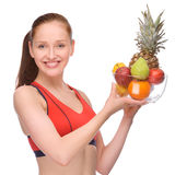 Healthy eating. Full isolated studio picture from a young woman with some fruits royalty free stock photography