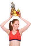 Healthy eating. Full isolated studio picture from a young woman with some fruits royalty free stock photo