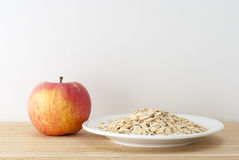 Healthy eating. Oatmeal in bowl, with  an apple Royalty Free Stock Image