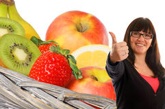 Healthy eating. Woman shows a thumbs up from various fruits Royalty Free Stock Photography
