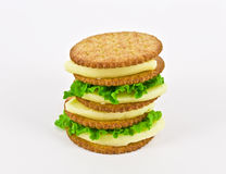 Healthy Eating. Crackers with cheese and lettuce over white royalty free stock image
