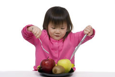 Healthy eating. A young girl with a plate full of fruits Royalty Free Stock Images