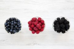 Bowls containing berries: blueberries, blackberries, raspberries, top view. Healthy eating. From above, overhead Stock Photo