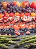 Healthy eating background. Food different fruits, asparagus, berry on concrete background royalty free stock image