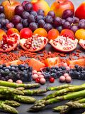 Healthy eating background. Food different fruits, asparagus, berry on concrete background stock photo