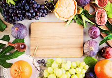 Healthy Eating Background with Organic Fruits. And Brown Wooden Board Royalty Free Stock Photos