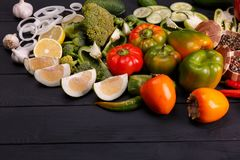 Healthy eating background studio photography of different fruits and vegetables on old wooden table royalty free stock photos