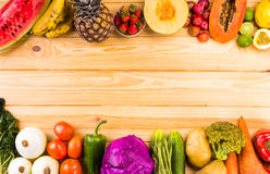 Healthy eating background. Studio photography of different fruits and vegetables on wooden table royalty free stock photos