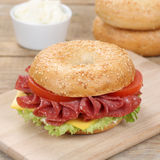 Healthy eating bagel sandwich for breakfast with salami ham Royalty Free Stock Images