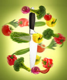 Healthy eating. Big chief knife with vegetables round it Royalty Free Stock Images