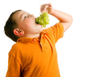 Healthy eating concept with child eating grapes Royalty Free Stock Photography