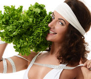 Healthy eating concept. Dieting. Woman hold lettuce broccoli and Stock Photos