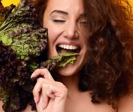 Healthy eating concept. Dieting. Woman hold lettuce looking at the corner stock image