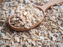 Healthy eating concept. Dry rolled oatmeal in bowl and spoon. Healthy eating concept. Dry rolled oatmeal in bowl and spoon Stock Photo