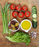 Healthy eating concept food set - asparagus, tomatoes, olives, oil, green salad Stock Image