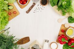 Healthy eating concept - fresh raw green salad, cherry tomatoes, paprika, spinach, cabbage and olive oil on white wood board, top. View Stock Photos