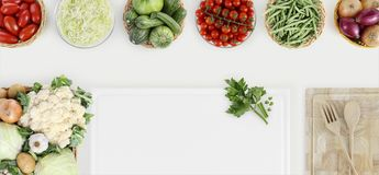 Healthy eating concept with fresh vegetables and cooking ingredi. Ents on kitchen white worktop, copy space, top view Stock Photography