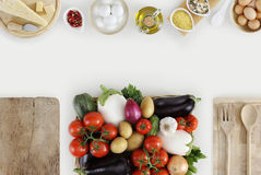 Healthy eating concept with fresh vegetables and cooking ingredi. Ents on kitchen white worktop, copy space, top view Royalty Free Stock Images