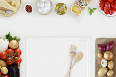 Healthy eating concept with fresh vegetables and cooking ingredi. Ents on kitchen white worktop, copy space, top view Royalty Free Stock Image