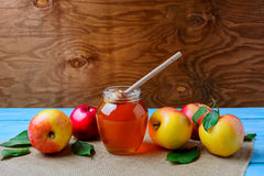 Healthy eating concept with glass honey jar and fresh apples, co Royalty Free Stock Images