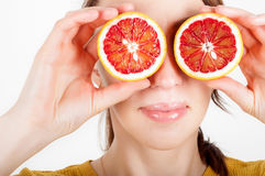 Healthy eating concept. Joyful happy young woman holding juicy o Stock Photography