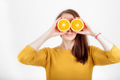Healthy eating concept. Joyful happy young woman holding juicy o Royalty Free Stock Image