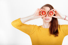 Healthy eating concept. Joyful happy young woman holding juicy o Stock Images